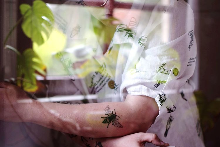 Coloured bee. Reflection Light Experiment Bee This Is My Skin Tattoo One Person Real People Midsection Focus On Foreground Indoors  Day Leisure Activity Lifestyles Close-up Clothing Front View Plant Nature A New Perspective On Life