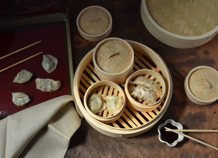 Dim Sum pot stickers in bamboo steamer Bamboo Chinese Food Dim Sum Dim Sum Lunch Freshness Group Of Objects High Angle View Indoors  Plate Pot Stickers Ready-to-eat Steamer Tray