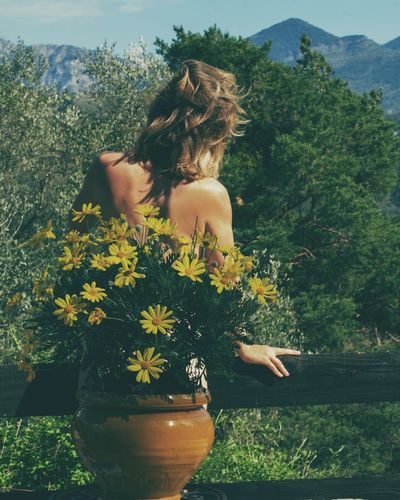 Flower Plant One Person Growth Nature Day Rear View Young Adult Young Women Tree Outdoors Freshness Beauty Beauty In Nature Beautiful Woman Women Real People Fragility People