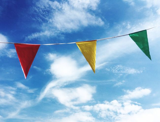 Summer time bunting Party Celebration Colourful Bluesky Sky Hanging Cloud - Sky Celebration Blue Low Angle View No People Decoration Multi Colored Bunting Day String Triangle Shape Clothesline Drying Flag Outdoors
