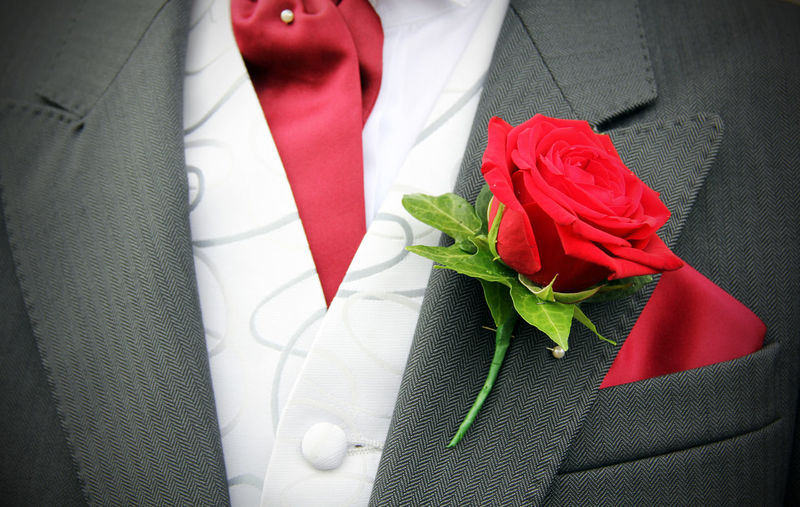 Bouquet Celebration Celebration Event Close-up Day Flower Flower Head Gift Groom Indoors  Life Events Midsection No People Page Boy Red Red Rose - Flower Roses Tied Bow Wedding Wedding Wedding Day Wedding Dress Wedding Photography Well-dressed