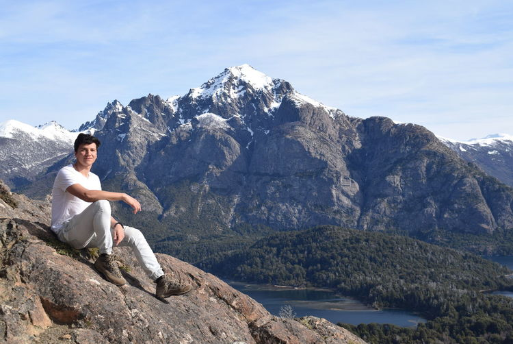 Portrait of man sitting on mountain