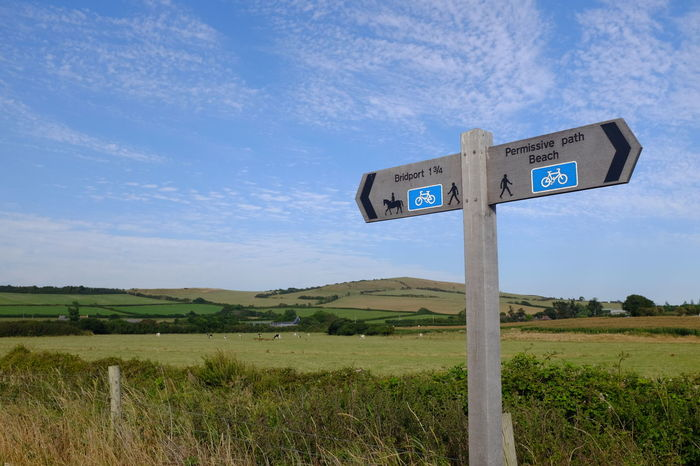 Blue Sky Communication Cloud - Sky Text Road Sign No People Outdoors Nature Landscape Day Agriculture Beauty In Nature Dorset Countryside Countrylife England English Countryside West Bay Dorset Uk Footpath Signs X100t EyeEmNewHere