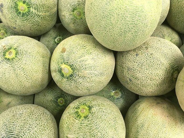Full frame shot of cantaloupes for sale at market stall