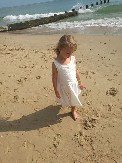 Beach Sand Childhood Sunlight Summer Girls Casual Clothing Innocence Full Length Shore Sunny Water Vacations Sea Bournemouth White Dress Bournemouth White Dress Playing Innocence Shadow Beach Sand Shore Childhood Sunlight