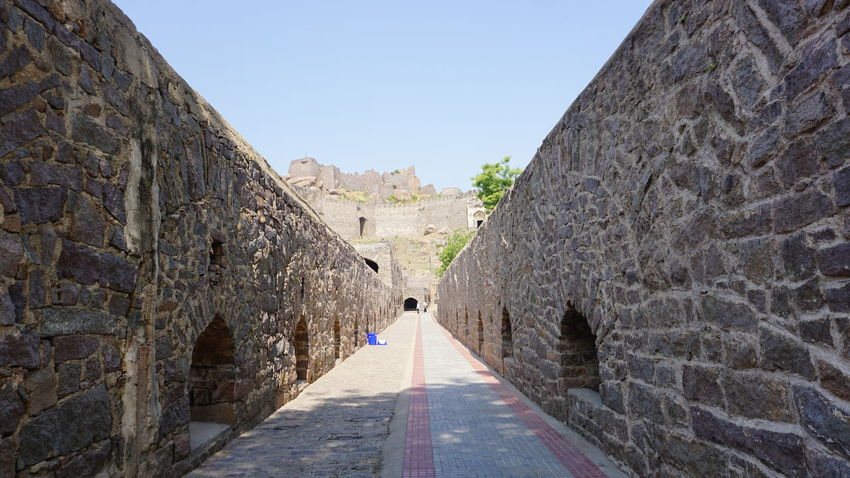 Stone down pathway which takes you to Golkonda Fort highest point Travel Destinations The Way Forward Day Architecture Ancient Outdoors Road Built Structure Clear Sky Ancient Civilization No People Sky Sony A6000 Sonyalpha Nwin Photography Golkonda Fort, Hyderabad Hyderabaddiaries Hyderabad Heritage Hyderabad Monuments Stone Stone Wall