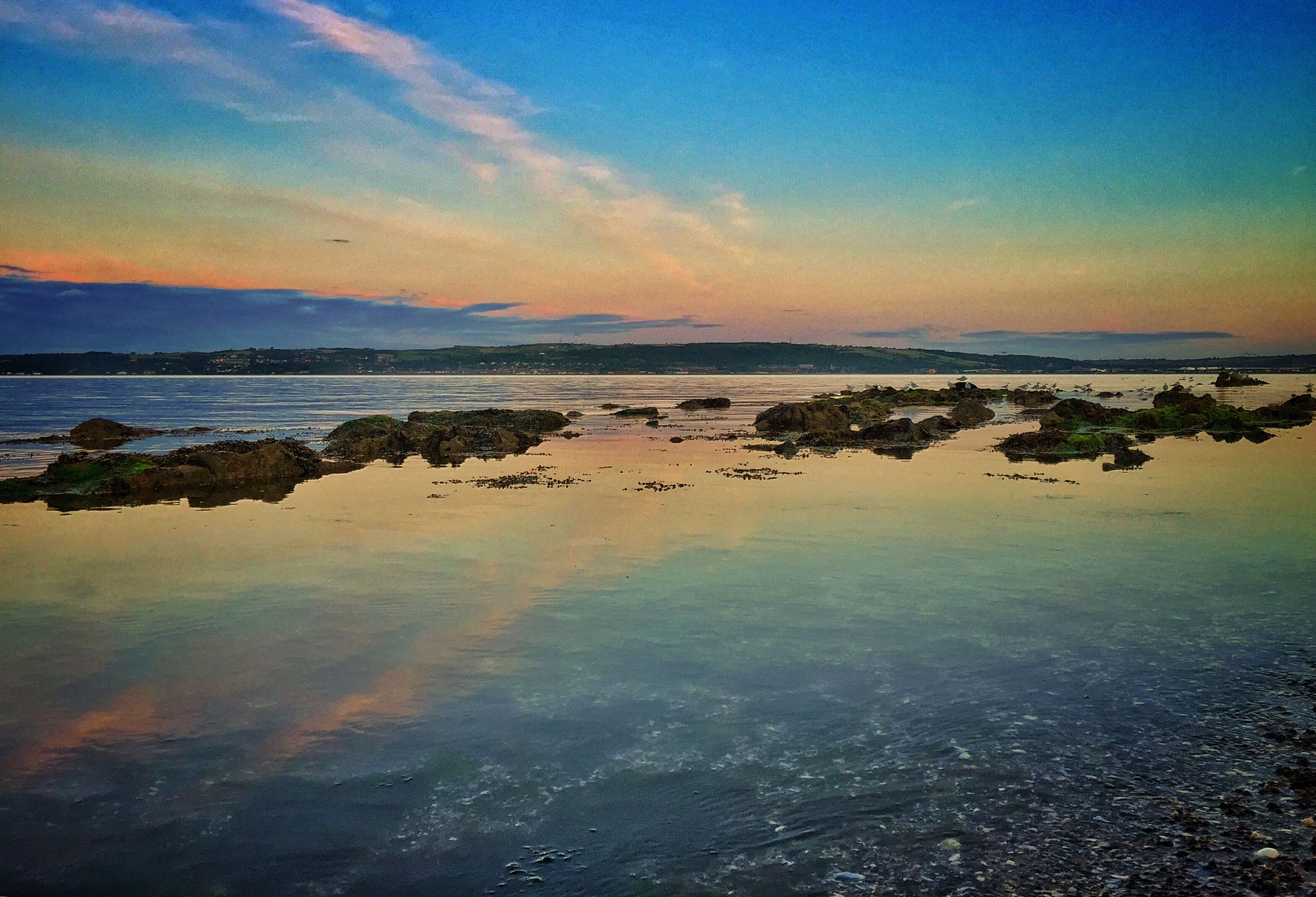 sea, water, sunset, scenics, horizon over water, tranquil scene, beauty in nature, tranquility, sky, beach, nature, idyllic, shore, orange color, waterfront, coastline, reflection, outdoors, high angle view, ocean