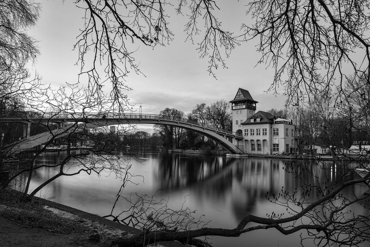 Berlin Treptower Park Berlin Insel Der Jugend Treptower Park Architecture Bare Tree Blackandwhite Branch Bridge - Man Made Structure Building Exterior Built Structure Connection Covered Bridge Day Monochrome Nature No People Outdoors Reflection River Schwarzweiß Sky Tree Treptow Water