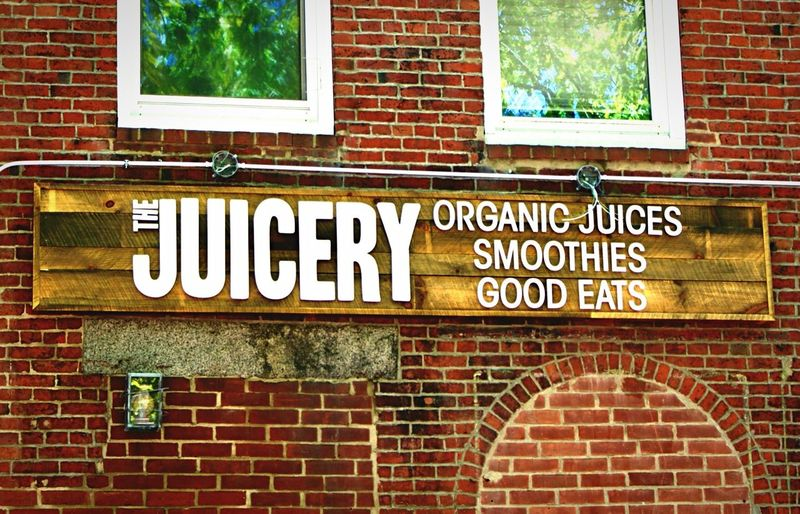 Brick Wall Brick Window Building Exterior Architecture Built Structure Day Outdoors Newburyport MA Wood - Material Wooden Sign Juicery Text No People Close-up Organic Smoothies
