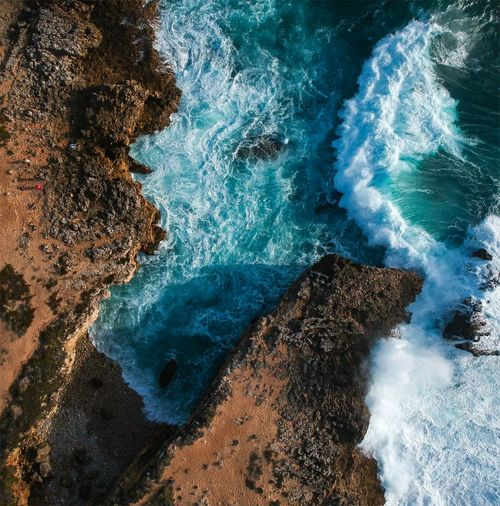 High Angle View Of Rocks And Sea