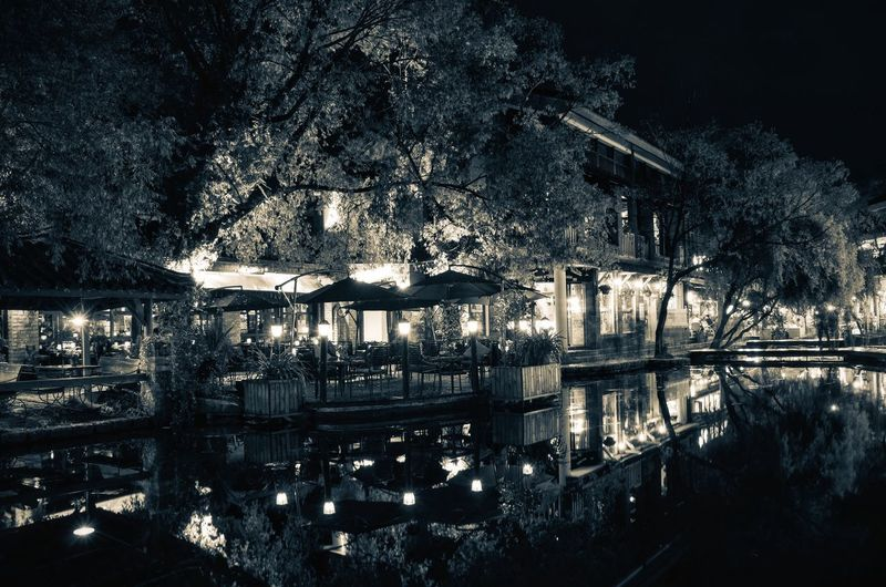 A Night in Lijiang Market Stall Restaurant Village River Light And Shadow Night Bar Reflection Blackandwhite Black & White B&w Street Lijiang Water Reflection Nature No People Tree Architecture Outdoors Built Structure City