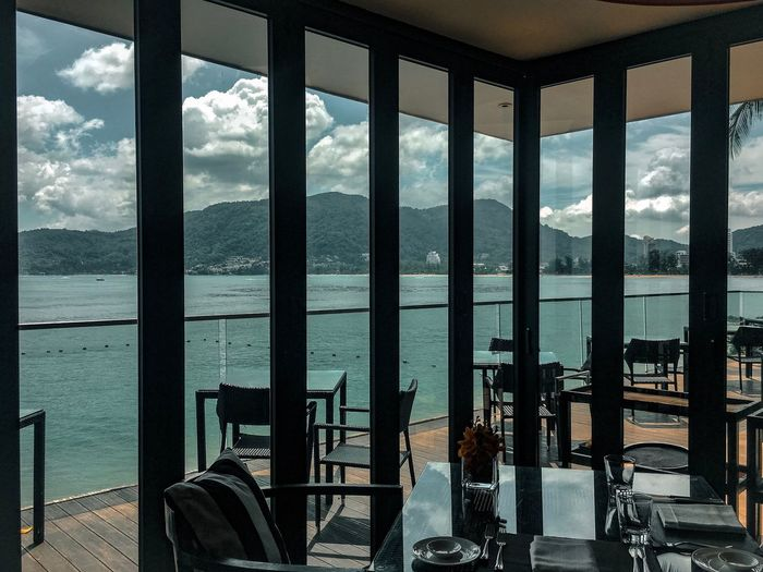 Panoramic view of sea against sky seen through window