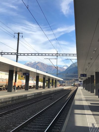 Sky Transportation Railroad Track Rail Transportation Built Structure Cable Building Exterior Architecture Railroad Station Power Line  Railroad Station Platform Day Outdoors Cloud - Sky No People Public Transportation EyeEmSwiss Mountains Mountain Range Visp Railwaystation Railway Leading Lines Perspective