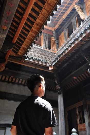 Architecture Built Structure Rear View Real People One Person Lifestyles Building Exterior Place Of Worship Low Angle View Indoors  Spirituality Religion Men Architectural Column Standing Young Adult Day People Adult Nikon Anhui,China