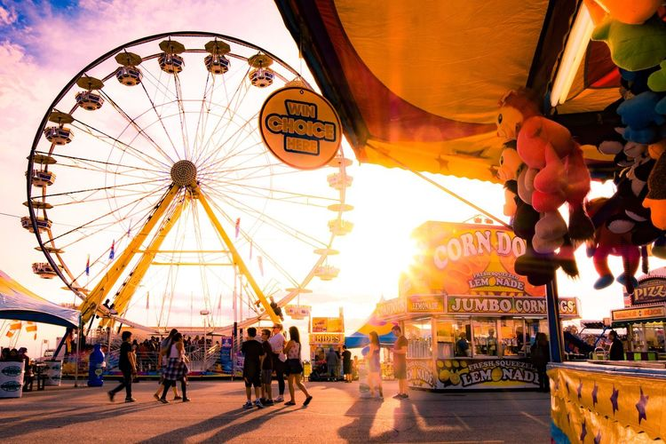 Amusement park Amusement Park Amusement Park Ride Ferris Wheel Arts Culture And Entertainment Architecture City Travel Crowd Sky Built Structure Travel Destinations Illuminated Group Of People Large Group Of People Building Exterior Traveling Carnival Nature Tourism
