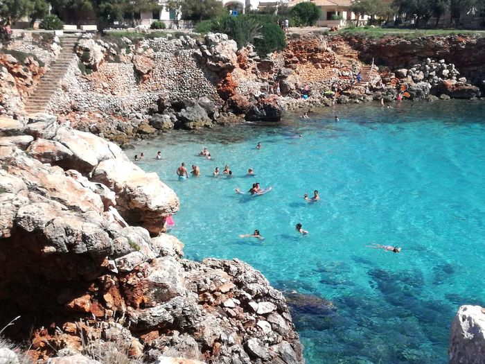 Calas Hermosas De Mallorca Lagoon Turquoise Water Turquoise Sea Beachphotography Beach View Rocky Coastline Mallorca (Spain) Mediterranean Sea Water Beach Tree High Angle View People In The Background Place Of Interest Elevated View Coast Shore Calm Rock Formation Ocean Rock Turquoise Leisure