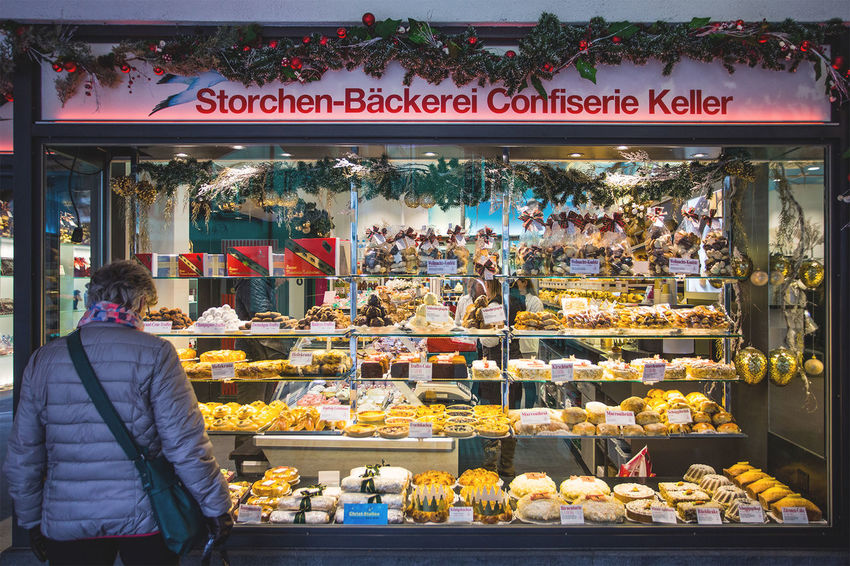 Swiss Bakery Abundance Buying Choice Day Display Food For Sale Freshness Large Group Of Objects Leisure Activity Lifestyles Market Market Stall Medium Group Of People Men Outdoors Retail  Sale Shop Shopping Small Business Store Street Market Variation