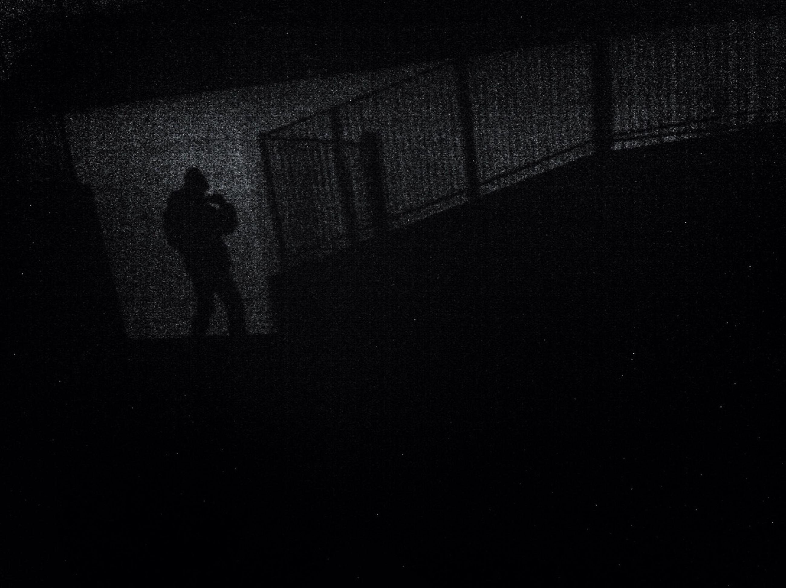 silhouette, dark, men, lifestyles, indoors, shadow, standing, unrecognizable person, leisure activity, night, outline, built structure, architecture, focus on shadow, wall - building feature, person, walking