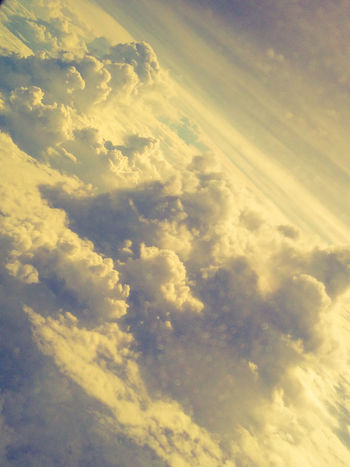 the world of skies and clouds Clouds And Sky Clouds Cloudy Cloudy Skies Airplaneview Space Flying Backgrounds Yellow Sunlight Aerial View Sunset Heaven Full Frame Sky