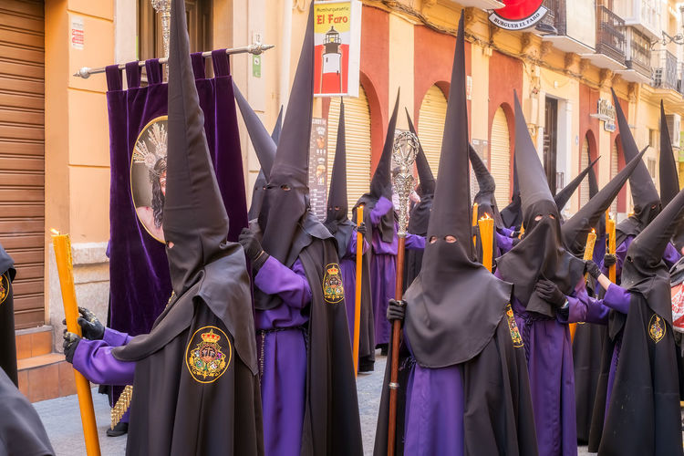 People in the procession in the Holy Week (Semana Santa) in a Spanish city. Malaga, Spain - March 26, 2018. Catolic Church Children Easter Easter Ready Historical Building Holy Week Malaga People Watching SPAIN Semana Santa Spanish Uniform Uniforms Architecture Belief Building Exterior Built Structure Catolicism Celebration City Clothing Day España Festival Group Of People Lifestyles Musical Instrument Musician Musician Bands Obscured Face Old Buildings People Procession Purple Real People Religion Sabor Spain Is Different Spanish Arquitecture Spanish Culture Street Togetherness Traditional Clothing Women The Street Photographer - 2018 EyeEm Awards