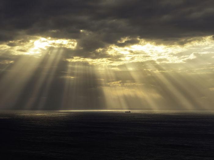 Beautiful sun rays above the sea.