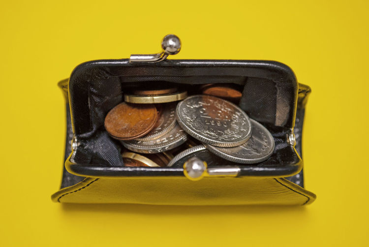 Close-up of coins on yellow background