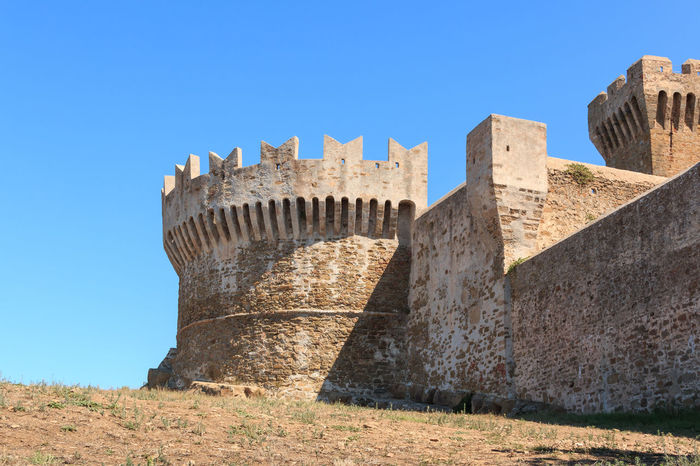 The fortress of Populonia, Tuscany, Italy Burg Festung Populonia Ancient Ancient Civilization Archaeology Architecture Blue Building Exterior Built Structure Clear Sky Day Fort Fortness History Low Angle View Nature No People Outdoors Ruined Sunlight The Past Tourism Travel Travel Destinations