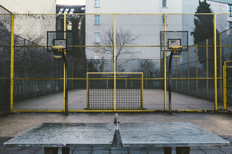 street soccer cage at Kreuzberg Backgrounds Barbed Wire Basket Basketball Berlin Berliner Ansichten Cage Fence Focus On Background Football Full Frame Gate Kreuzberg Metal No People Pattern Safety Soccer Street Street Photography Streetphotography Tabletennis The Way Forward Yellow Playground