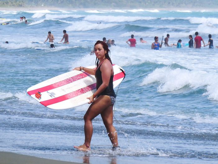 Surf's Up Stolenshot Candid Sneak Shot She did notice, though. :P Surfing Surf Girl Surf Photography Surfer Baler Aurora Philippines Pretty Girl Strong Woman Cool Gal The Portraitist - 2016 EyeEm Awards Girl Power