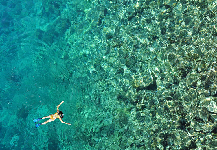 Aerial view of woman snorkeling in tropical sea water. Drone view Drone  Heaven Snorkeling Summer Vacation Thailand Above View Bikini Drone View Emerald High Angle View Ocean One Woman Only Refreshment Sea Seascape Snorkel Summer Swimming Swimwear Tropical Turquoise Water Underwater Vacations Vitality Water