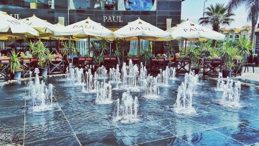 Water Fountains Outdoors DayThis Is Egypt ❤ Clear Sky Building Exterior Urban Skyline Reflection No People Architecture Architecture Sky City Life Built Structure Scenics Cityscape People Real People City Downtown District Arts Culture And Entertainment Egyptdailylife Photographing
