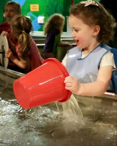 Sami! Bucket Water Playing Children Watertable Ohio, USA Cincinnati Union Terminal