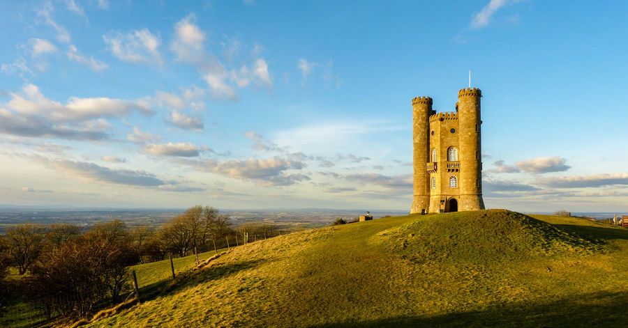 This is the Broadway Tower in England's Cotswold County of Worcestershire. The blue sky and light made for a perfect postcard picture. Broadway Tower Castle Castles Postcard Beauty In Nature Blue Sky Castle Ruin Cloud - Sky Cotswold Cotswolds Grass History Nature No People Postcards Scenics Tower Tranquility