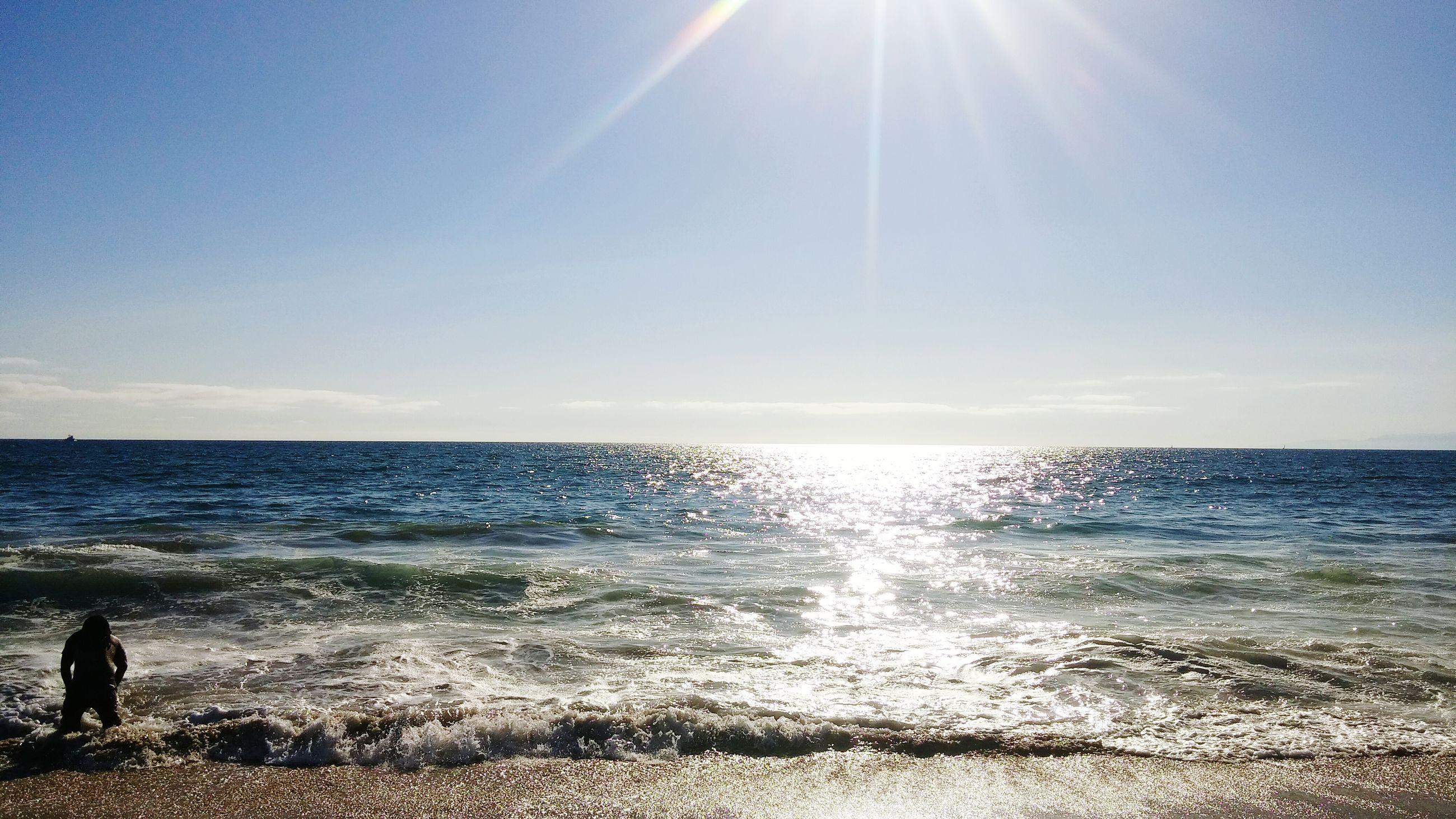 sea, sun, horizon over water, water, sunbeam, sunlight, beach, scenics, lens flare, tranquil scene, beauty in nature, tranquility, sky, shore, nature, sunny, idyllic, blue, bright, silhouette