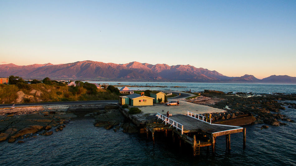 091 kaikoura warf sunrise mountains colors new zealand Drone  Wanderlust Aboutpassion Aerial Photography Aerial View Architecture Beauty In Nature Built Structure Clear Sky Copy Space Day Idyllic Lake Mountain Mountain Range Nature No People Non-urban Scene Outdoors Scenics - Nature Sky Tranquil Scene Tranquility Water