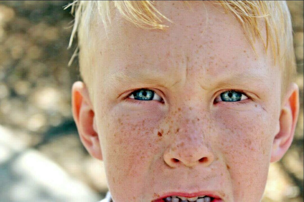 child, childhood, children only, sadness, looking at camera, portrait, human body part, human eye, human face, blond hair, eye, close-up, blue eyes, depression - sadness, boys, one person, elementary age, one boy only, people, girls, outdoors, day, hazel eyes