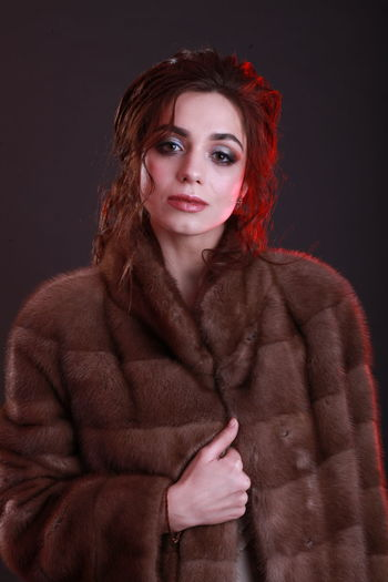 Portrait Beautiful Woman Fur Coat Fur Warm Clothing Black Background Studio Shot Studio Photography Fashion Fashion Model Style And Fashion Editorial Photography Looking At Camera One Person Young Adult Women Beauty Clothing Indoors  Red Standing Young Women Hairstyle Hair Dyed Red Hair