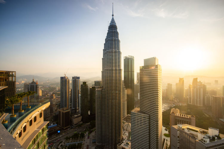 Kuala Lumpur skyline sunrise Office Building Exterior Building Exterior Built Structure Building Architecture Skyscraper Sky City Cityscape Modern Tower Travel Destinations Tall - High Sunset Nature Landscape Office Sunlight Urban Skyline No People Outdoors Financial District  Spire