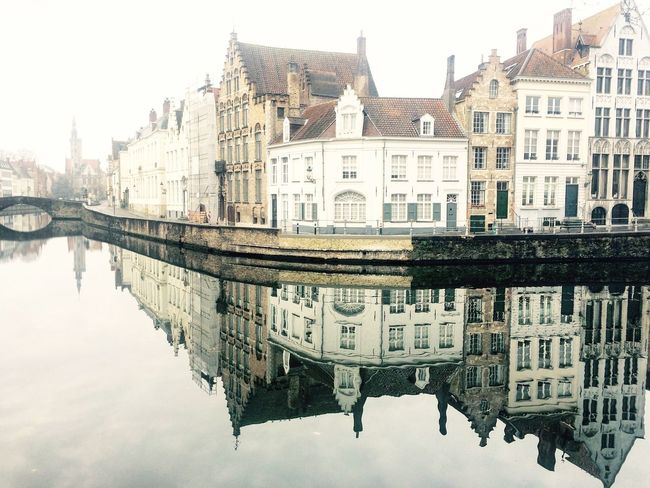 Warm i s i d e. Reflection Architecture Canal Brugge Belgium