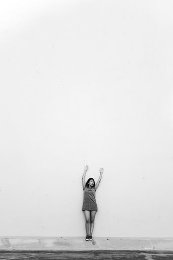 Adult Alone Day Full Length Negative Space One Person One Woman Only Only Women Outdoors People Real People Wall White Wall