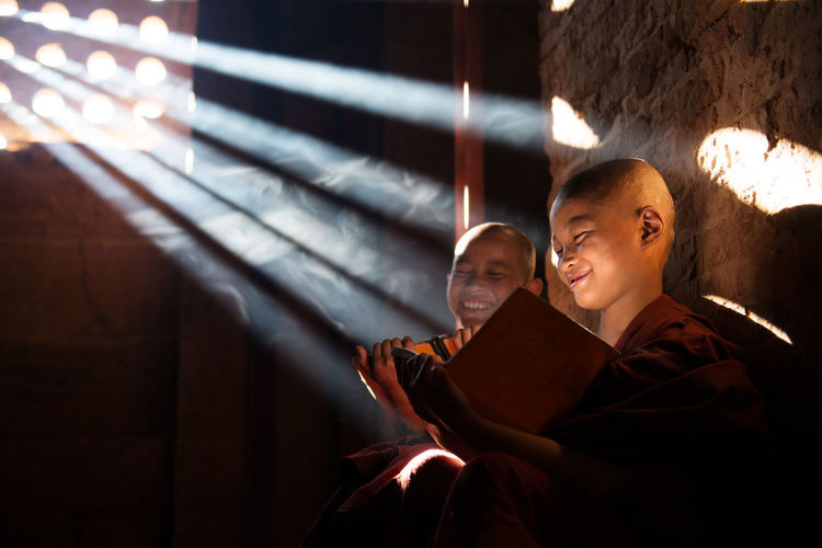 Happy monks reading book