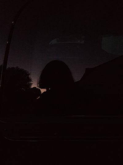 Silhouette people sitting in the dark