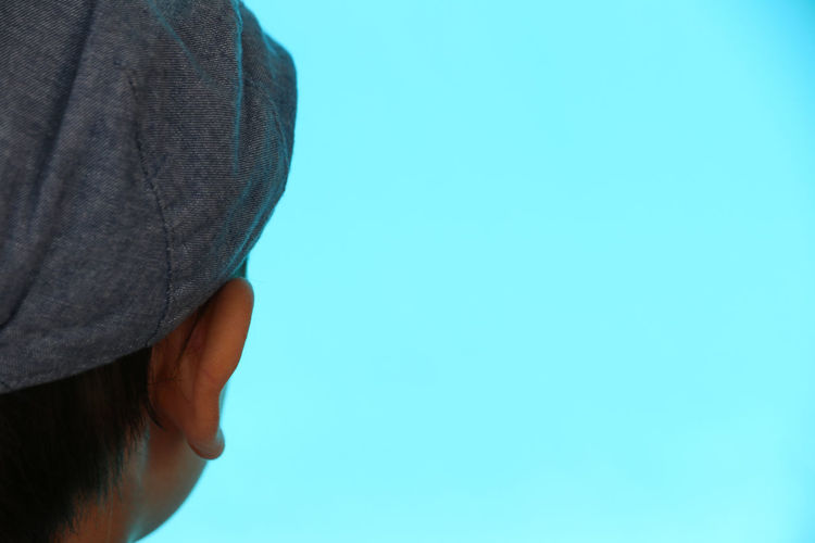 Boy looking into blue Hat Blue Body Part Boy Casual Clothing Close-up Copy Space Day Hand Headshot Headwear Human Body Part Human Face Human Hand Indoors  Leisure Activity Lifestyles Men Midsection One Person Real People Standing Women The Portraitist - 2018 EyeEm Awards The Fashion Photographer - 2018 EyeEm Awards