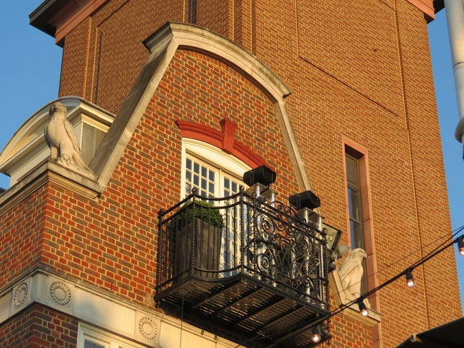 Balcony Brick Wall Hawk Architecture Balcony Building Exterior Built Structure City Day House Iron Balcony Low Angle View No People Outdoors Residential Building Sculptures Window