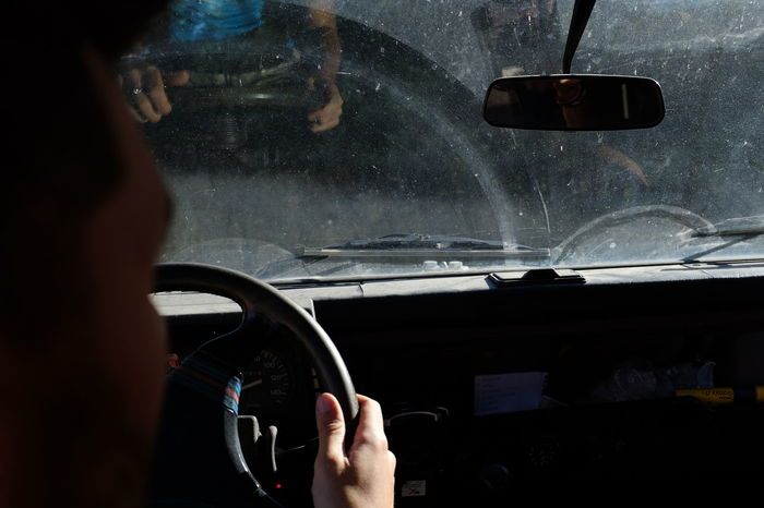 Adult Car Car Interior Car Wash Close-up Dashboard Day Driving Holding Human Body Part Human Hand Indoors  Land Vehicle Lifestyles Men Mode Of Transport One Person Real People Steering Wheel Transportation Vehicle Interior Water Wet Windscreen Windshield