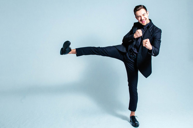 Achievement Happiness Kick Off Man Positive Result Adult Attitude Businessman Caucasian Fighting Stance Finish Full Length Looking At Camera One Person Portrait Positive Emotion Positive Vibes Real People Satisfaction Studio Shot Success Suit Well-dressed Young Adult