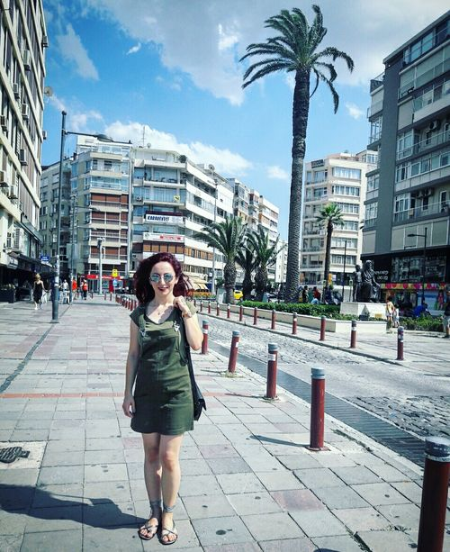 Izmirlife Alsancak Kordon Architecture Building Exterior Built Structure Lifestyles City Leisure Activity Casual Clothing Incidental People Full Length Person Sky City Life Young Adult Day Outdoors Footpath Person Vacations Pedestrian Walkway Paving Stone