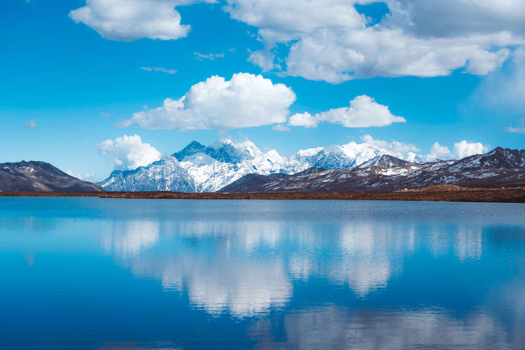 Blue sky, white clouds, snowy mountains, lake China Landscape Mountain Sky Cloud - Sky Beauty In Nature Nature Scenics - Nature Travel Destinations Travel Lake Reflection Day Snowcapped Mountain Water Tranquil Scene Waterfront Tranquility Mountain Range Environment Cold Temperature Winter Non-urban Scene No People Outdoors Mountain Peak