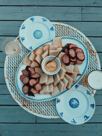 Sliced sausage with rye bread and mustard Sausage Kielbasa Polish Polish Sausage Mustard Plate Plating Plating Food Food Preparation Meals Rye Bread Top View Food And Drink Foodporn Foodphotography Plate Wood - Material Table High Angle View Food And Drink