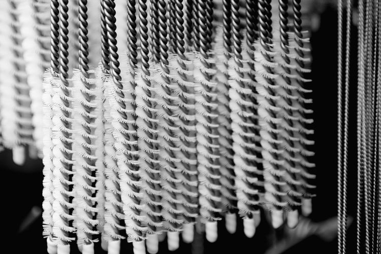 Close-Up Of Brushes For Sale At Night